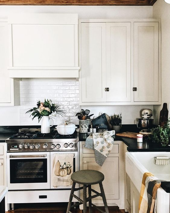 Farmhouse Tour - love this classic white kitchen with white stove and subway tile
