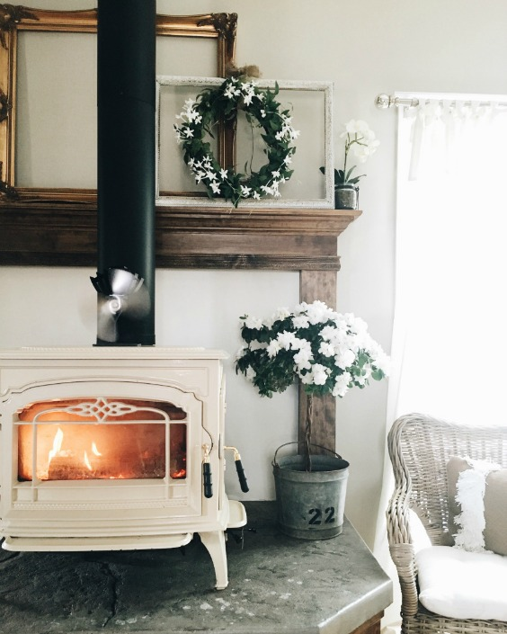 Farmhouse Tour - love this white wood burning stove