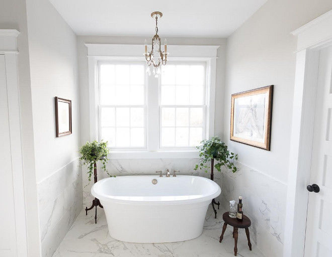 Eclectic Home Tour of Green Spruce Designs - love the marble bathtub surround