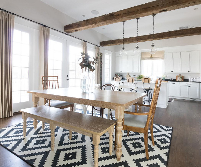 Eclectic Home Tour of Green Spruce Designs - antique beams add warmth and character to this white kitchen