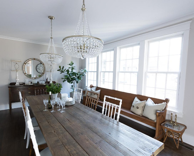 Eclectic Home Tour of Green Spruce Designs - love this dining room with old farm table, mismatched bamboo chairs and old church pew