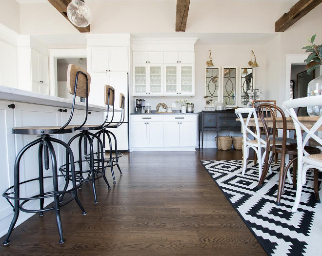 Eclectic Home Tour of Green Spruce Designs - love the antique wood beams in the white kitchen