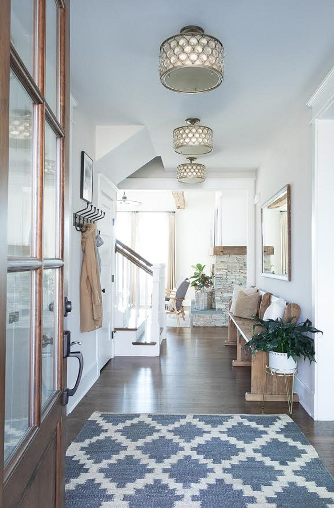 Eclectic Home Tour - this stunning new build is a perfect mix of new and old and I love the old church pew in the foyer kellyelko.com