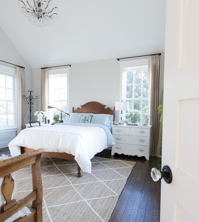 Eclectic Home Tour of Green Spruce Designs - neutral bedroom with crystal chandelier and painted bedside tables