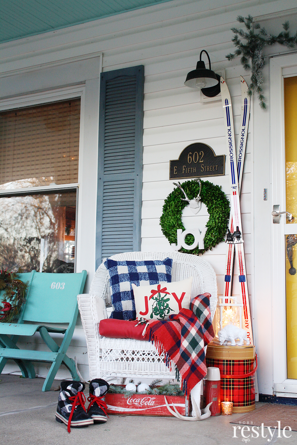 Eclectic Home Tour Christmas edition of Robb Restyle - love this porch filled with vintage finds including an old tartan thermos and a wooden soda crate