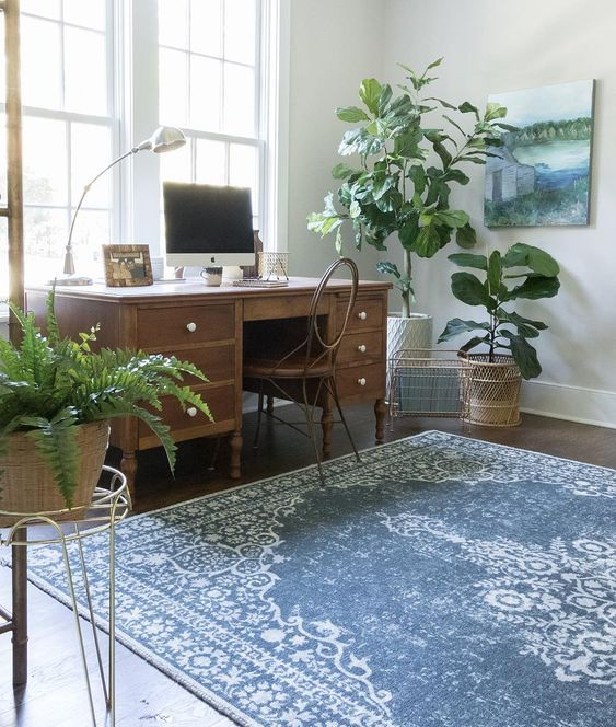 Eclectic Home Tour of Green Spruce Designs - love the blue over dyed rug and vintage desk