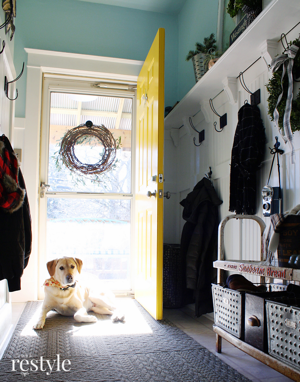 Eclectic Christmas Home Tour - love this foyer with yellow front door and vintage Sunbeam Bread shelf