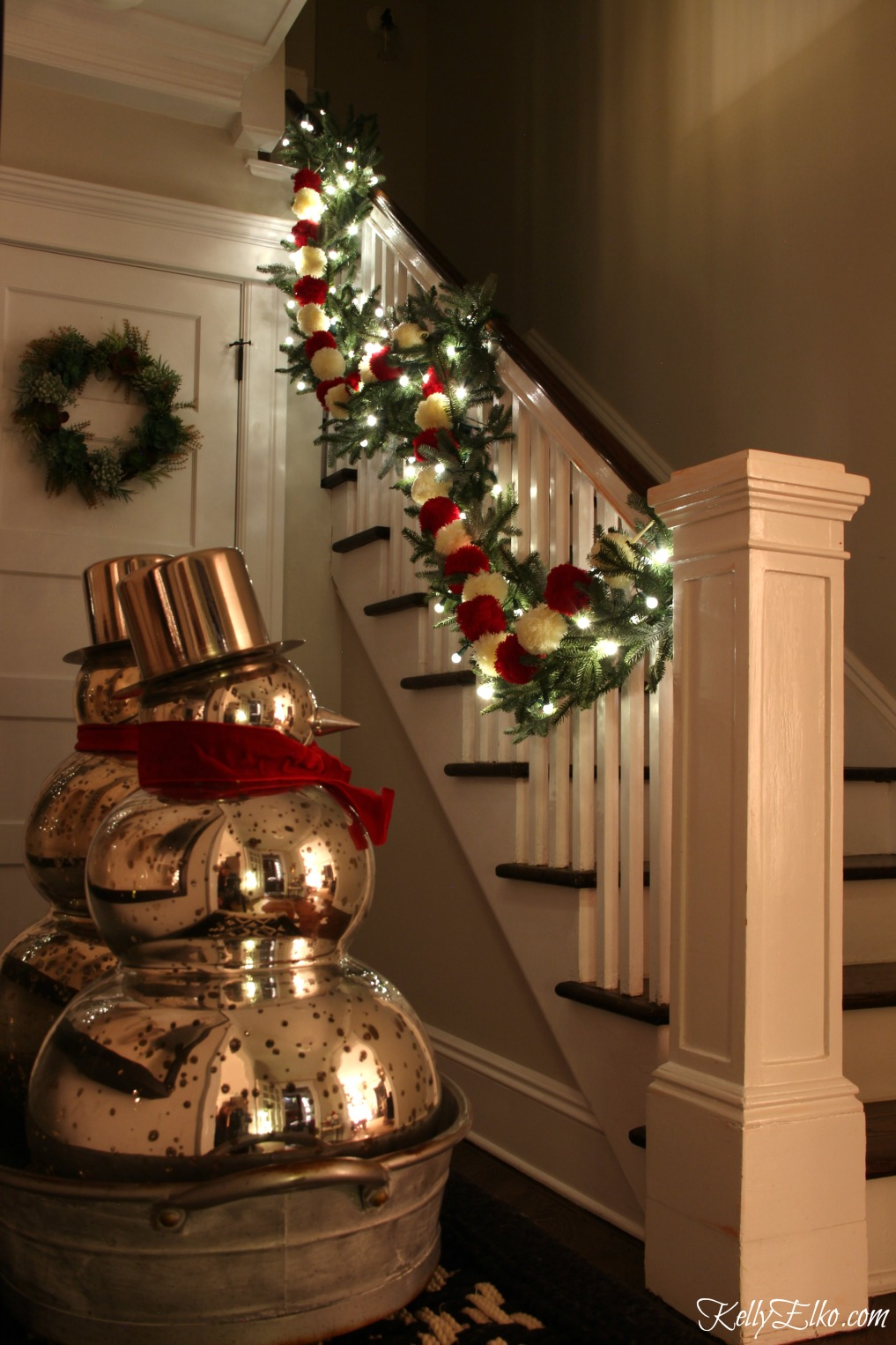 Christmas Nights Tour - see 25 of the best Christmas homes lit up at night! Love the garland on the bannister with pom poms and lights kellyelko.com #christmas #christmasdecorating #christmasdecor #christmaslights