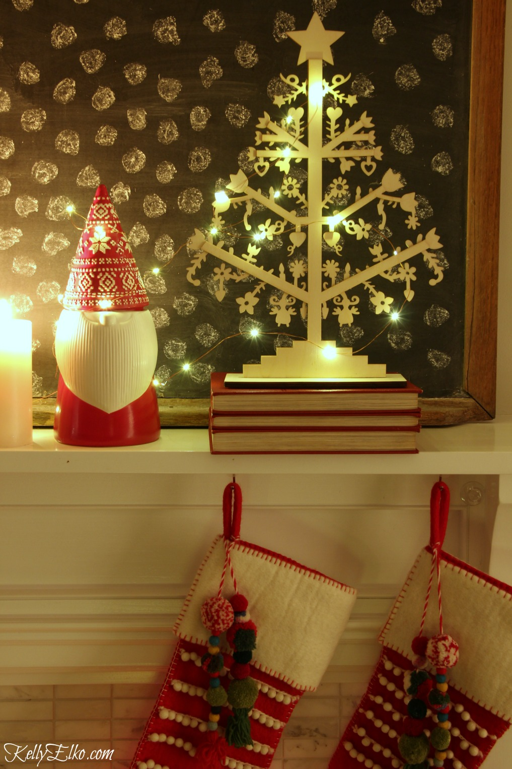 Christmas Nights Tour - see 25 of the best Christmas homes lit up at night! Love this cute little gnome and pom pom stockings kellyelko.com #christmas #christmasdecorating #christmasdecor #christmaslights