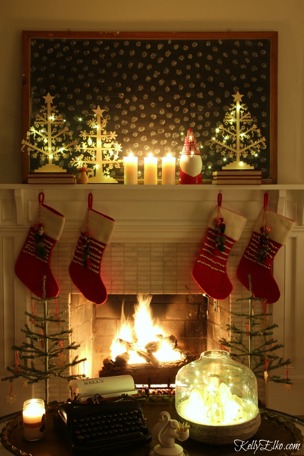 Christmas Nights Tour - see 25 of the best Christmas homes lit up at night! Love this mantel with giant chalkboard of snowflakes kellyelko.com #christmas #christmasdecorating #christmasdecor #christmaslights