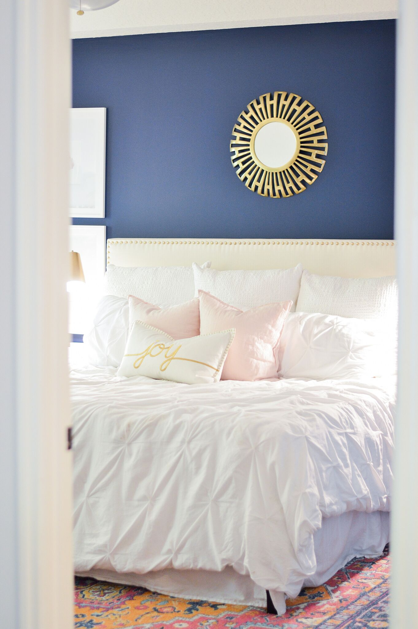 Christmas Eclectic Home Tour - love the navy blue paint in this master bedroom