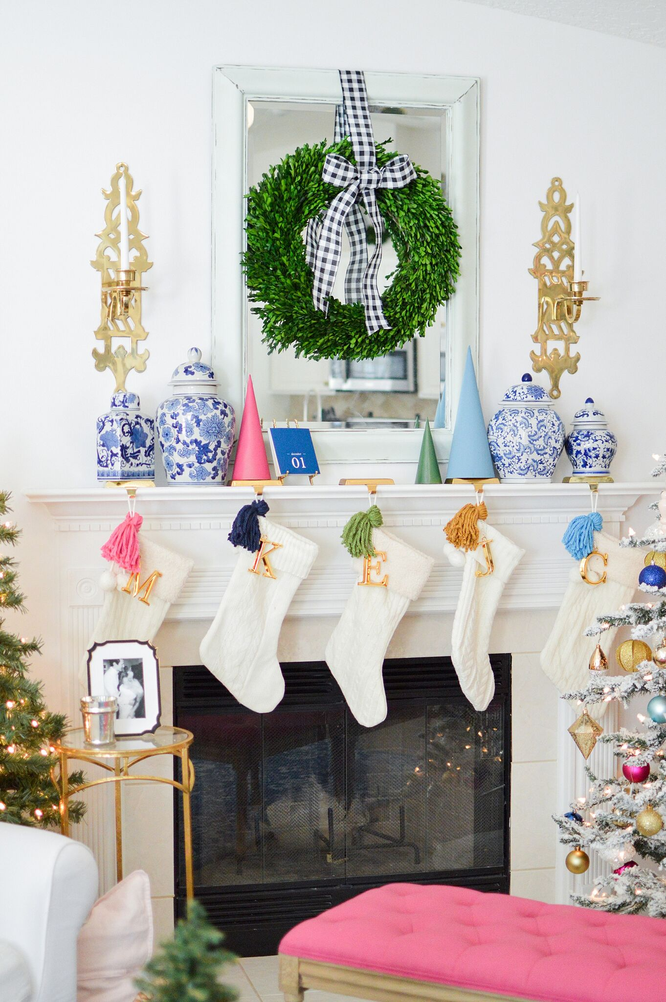 Christmas Eclectic Home Tour - love the colorful DIY tassels on the white stockings