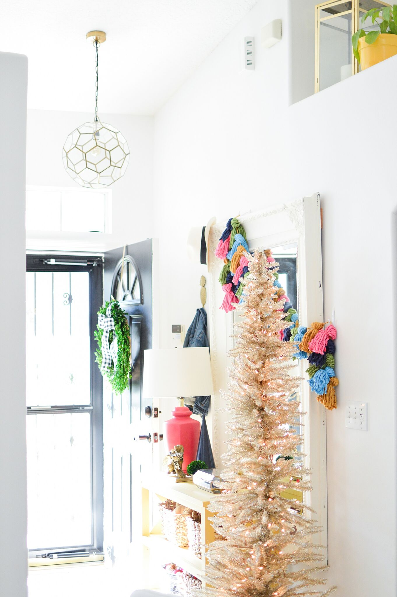 Christmas Eclectic Home Tour - love the slim white Christmas tree in the foyer