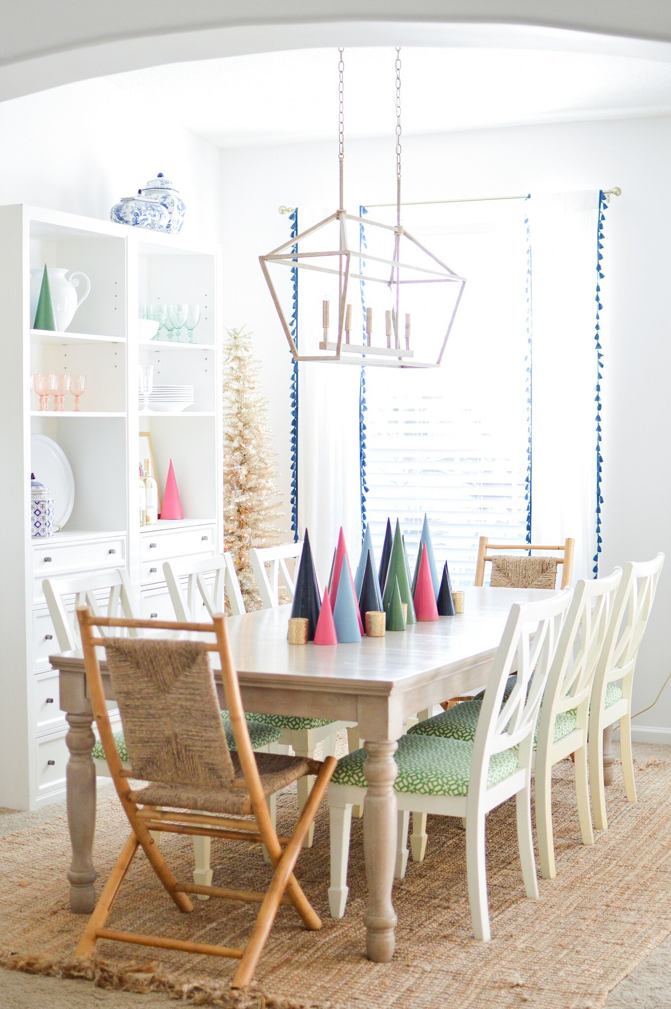 Christmas Eclectic Home Tour - love this dining room with colorful modern tree centerpiece