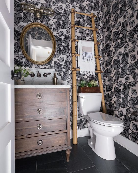 Eclectic Home Tour of Green Spruce Designs - love the graphic black and white wallpaper in this small powder room