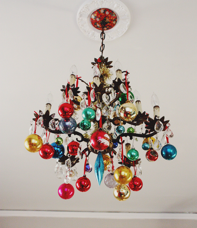 Christmas Home Tour - love this chandelier with vintage ornaments