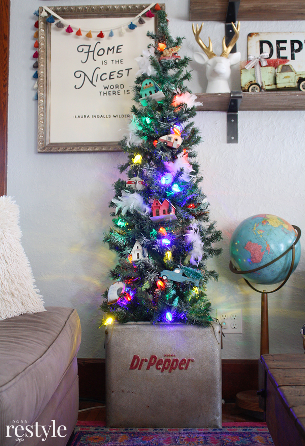 Eclectic Christmas Home Tour - love the vintage putz houses in the tree tucked into an old Dr Pepper cooler
