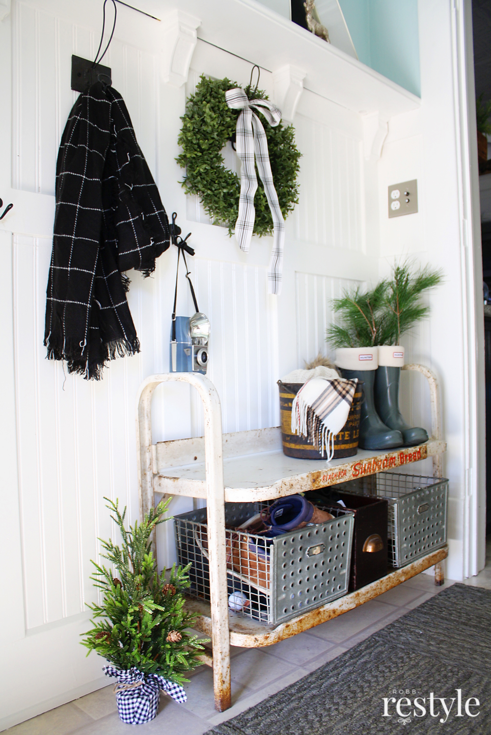 Eclectic Christmas Home Tour - wainscoting in the entry with vintage bread stand turned bench