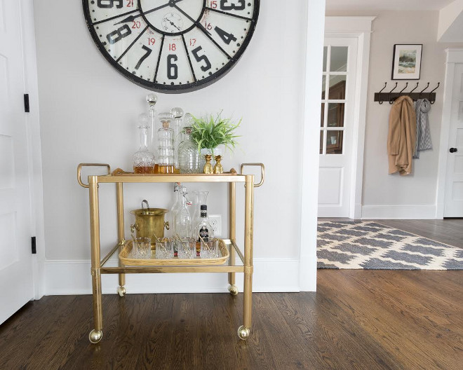 Eclectic Home Tour of Green Spruce Designs - love the vintage brass bar cart and huge clock