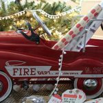 Christmas Details - love this red fire truck filled with wrapping paper kellyelko.com