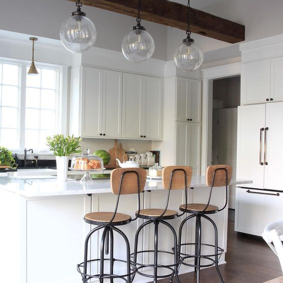 Eclectic Home Tour of Green Spruce Designs - love the white kitchen with vintage style wood barstools and glass lighting