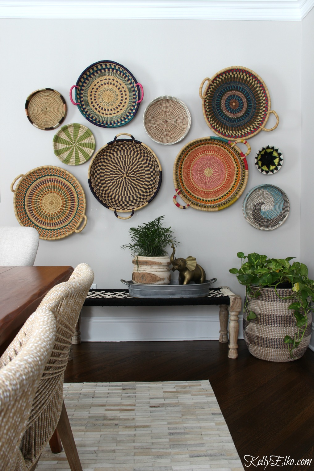 Basket Gallery Wall - love this colorful, eclectic, hand woven African basket wall and her unique way to hang them! kellyelko.com #basket #basketwall #gallerywall #bohodecor #bohemiandecor #eclecticdecor #vintagedecor #colorfuldecor #walldecor #diydecor