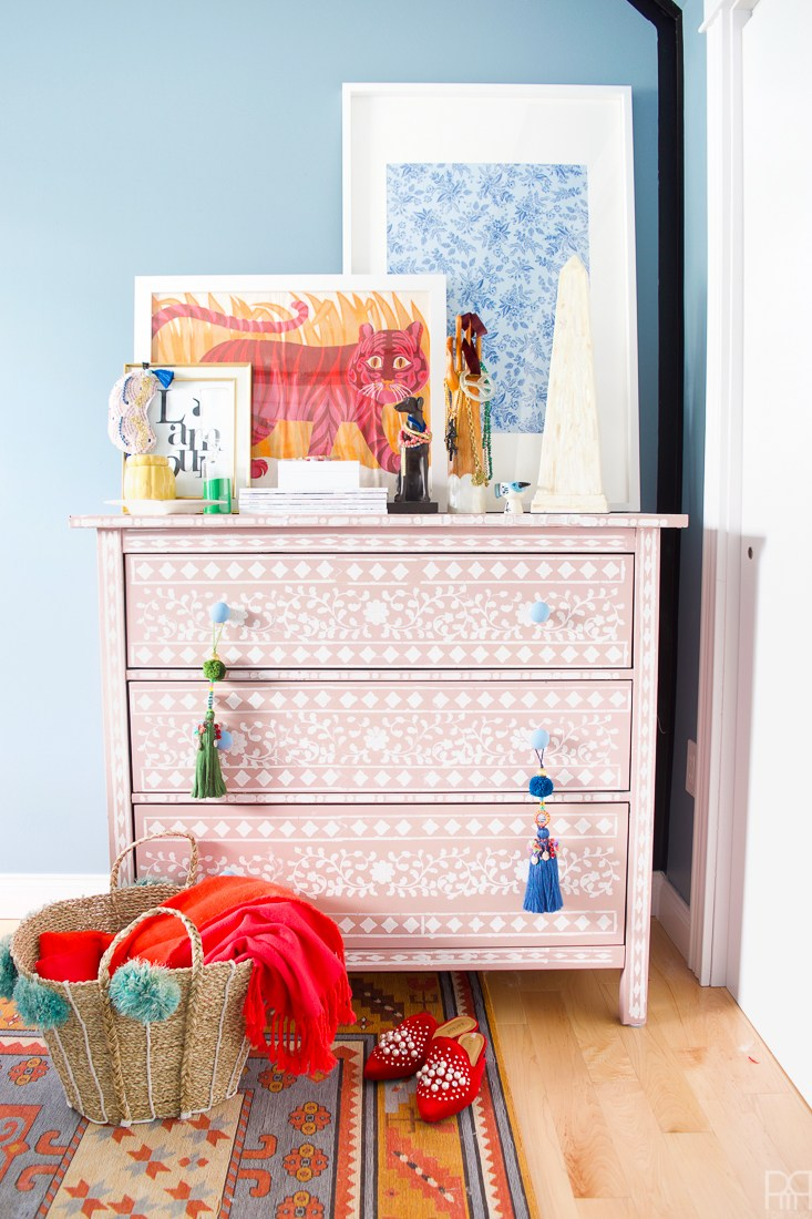 Eclectic Home Tour of PMQ for Two - get tons of renter friendly decorating and DIY ideas like this stenciled dresser that looks like inlaid bone