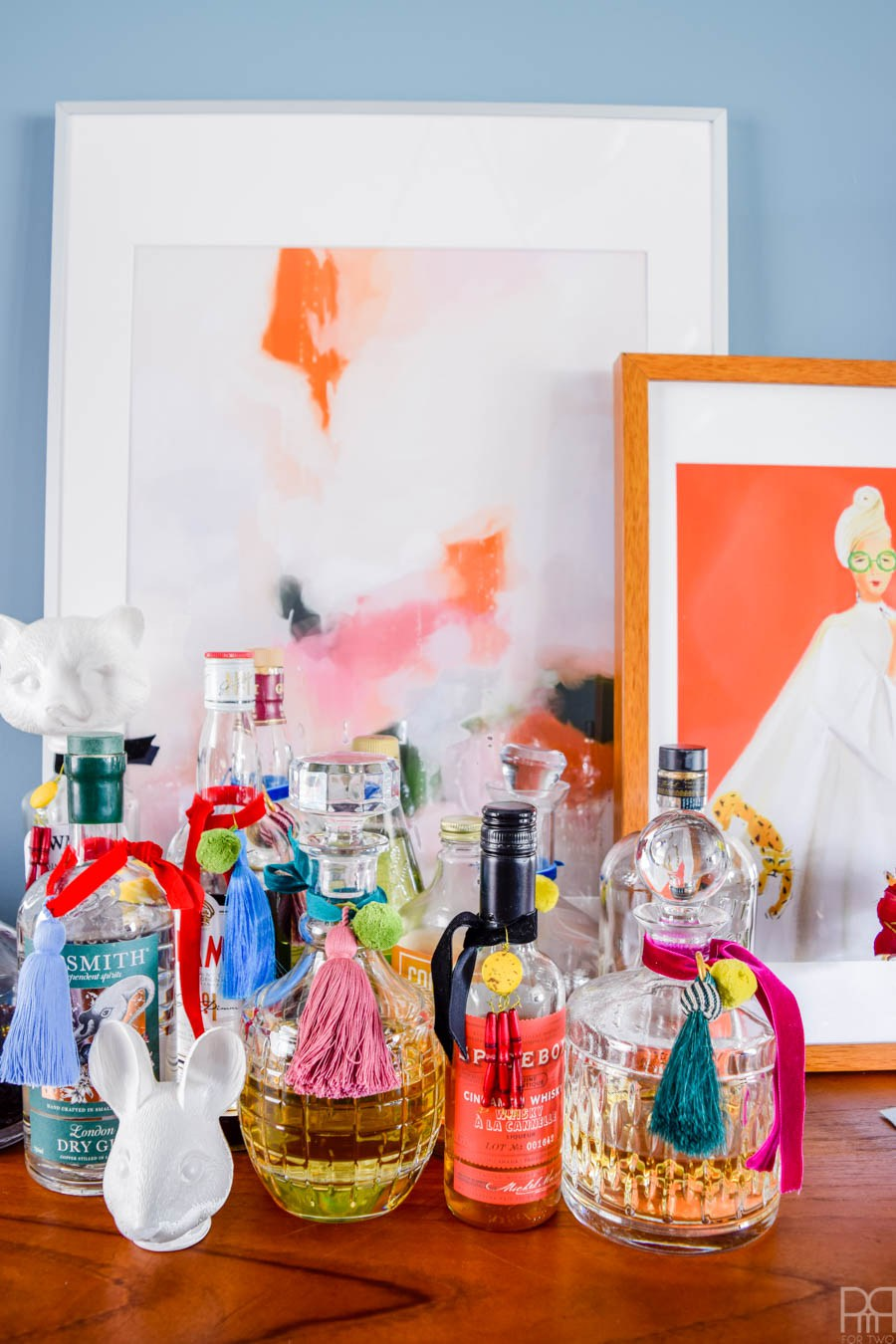 Eclectic Home Tour of PMQ for Two - get tons of renter friendly decorating and DIY ideas - love these DIY tassels for liquor bottles