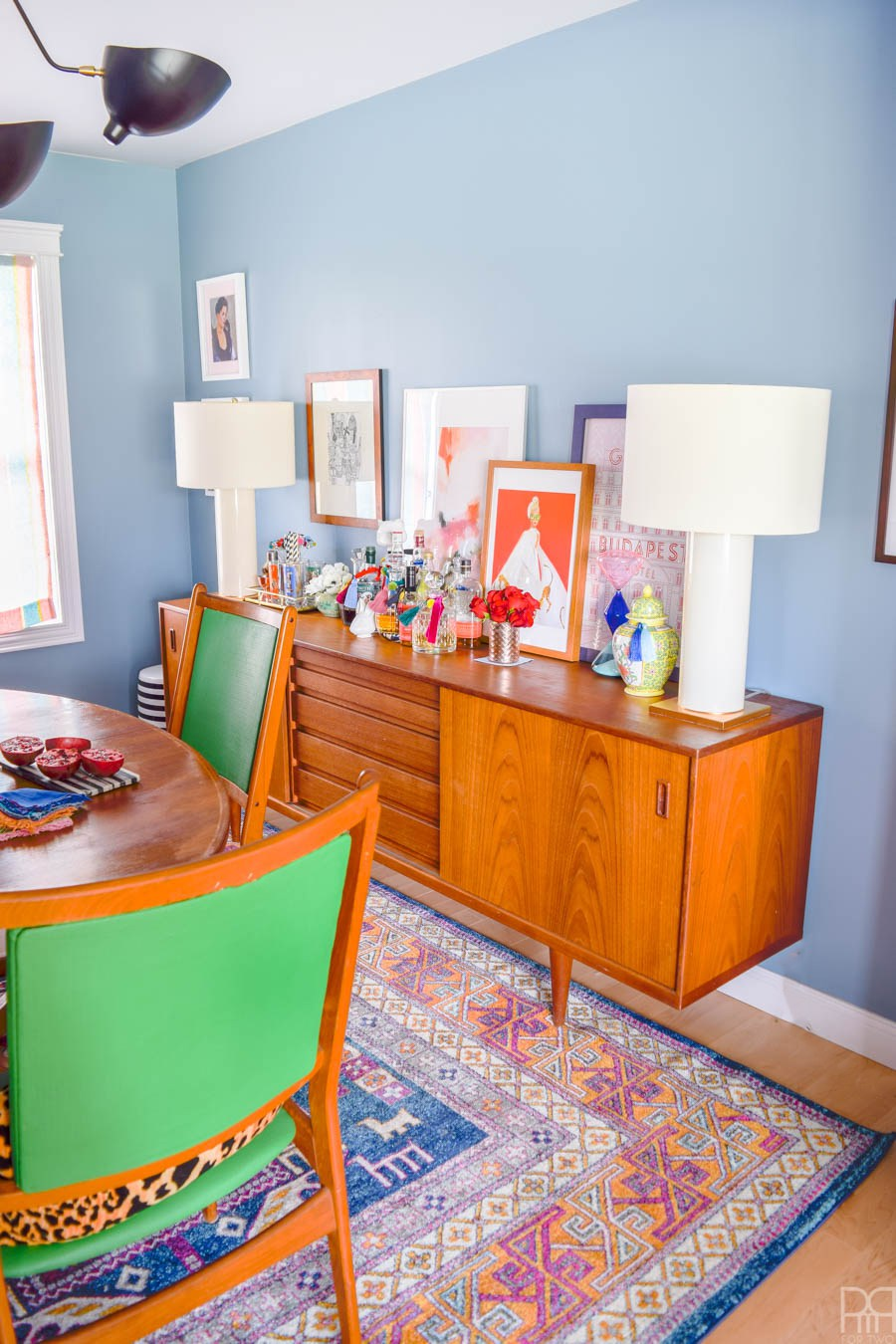 Eclectic Home Tour of PMQ for Two - get tons of renter friendly decorating and DIY ideas like this colorful, boho, mid century dining room