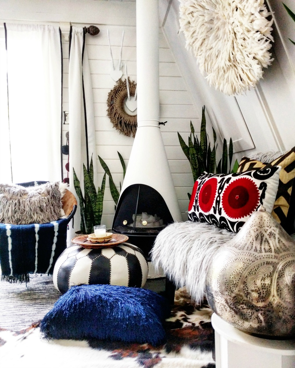 Eclectic Home Tour - Insieme House - tour this tiny house with boho flair - love the Moroccan pouf and the African Juju hat