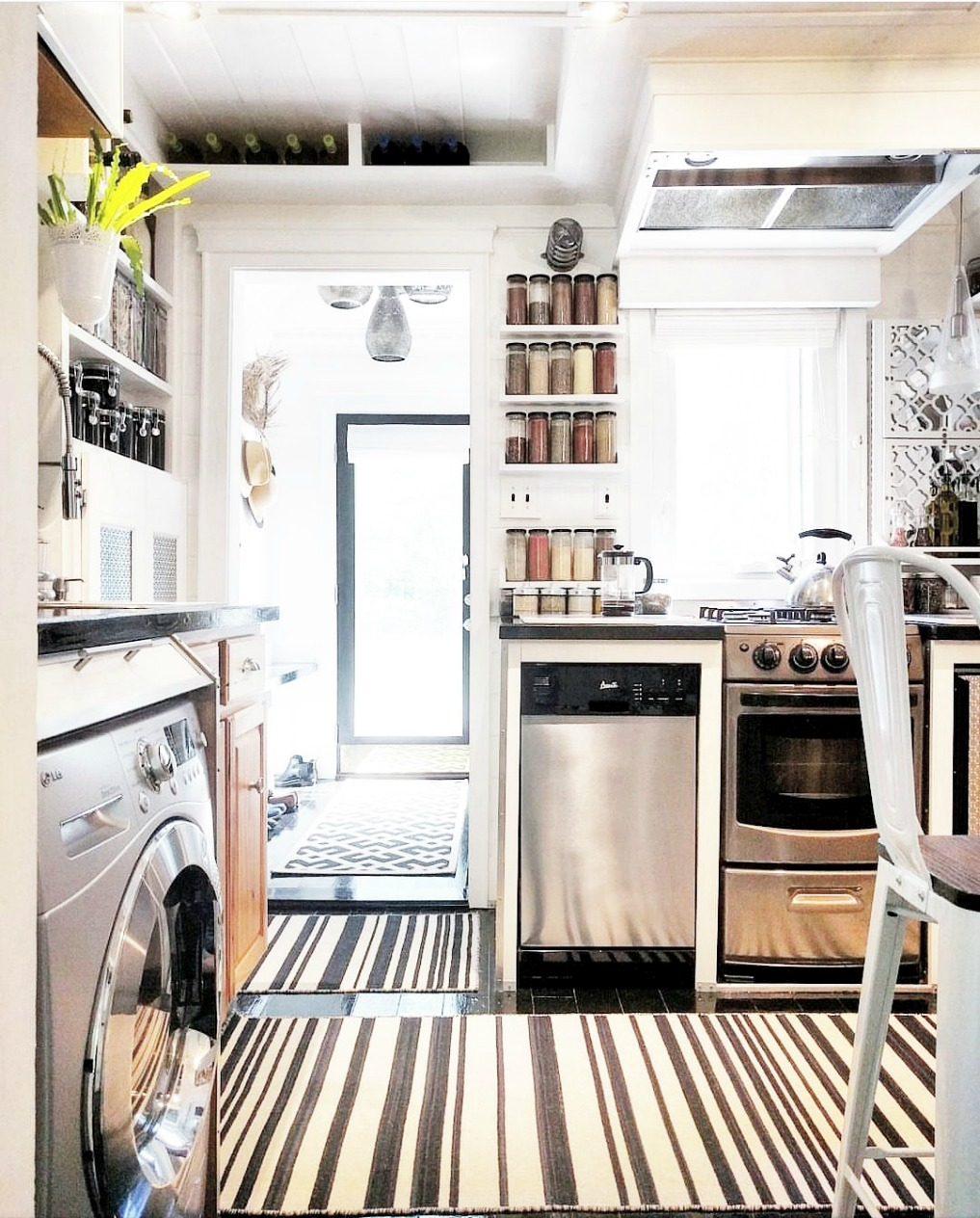 Eclectic Home Tour - Insieme House - tour this tiny house that has clever storage in this small kitchen laundry room combo
