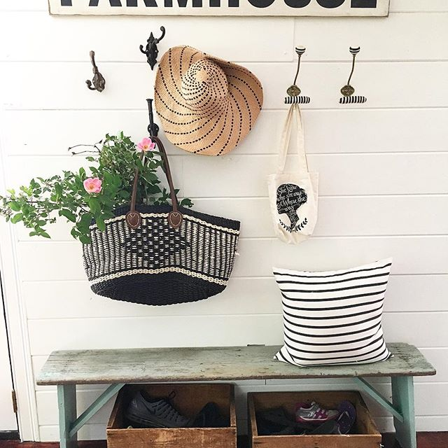 Eclectic Home Tour of Liv and Grace Restored - love the charming vintage touches like this mudroom with old bench and crate shoe storage kellyelko.com