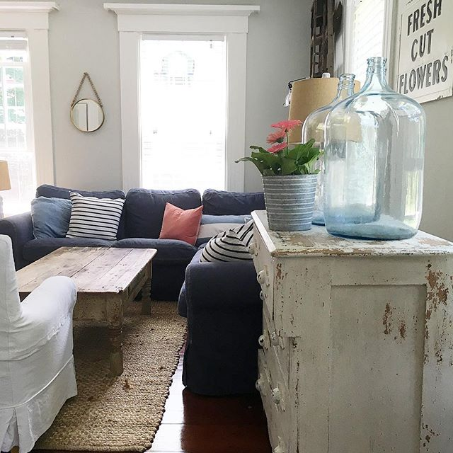 Eclectic Home Tour of Liv and Grace Restored - love this cozy family room with blue sectional sofa and chippy vintage furniture kellyelko.com