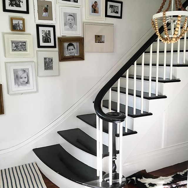 Eclectic Home Tour of Liv and Grace Restored - love the family photo gallery wall on the staircase in this antique home kellyelko.com