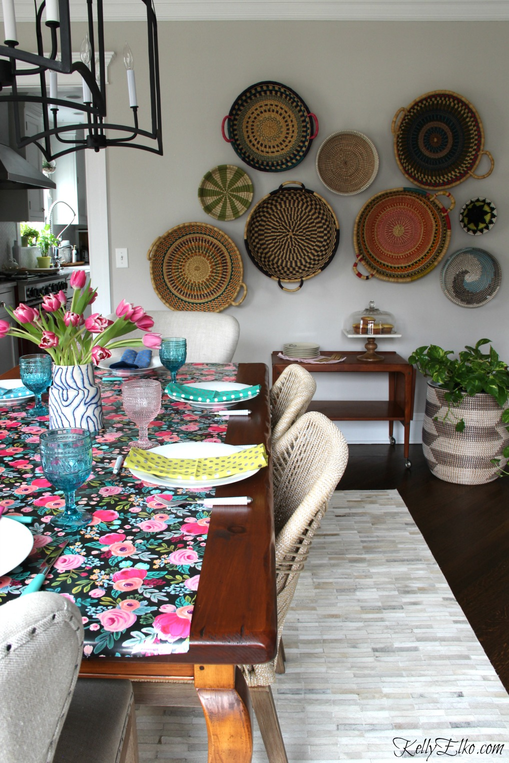 Spring Tablescape - love the floral table runner, pink and blue glasses and basket gallery wall kellyelko.com
