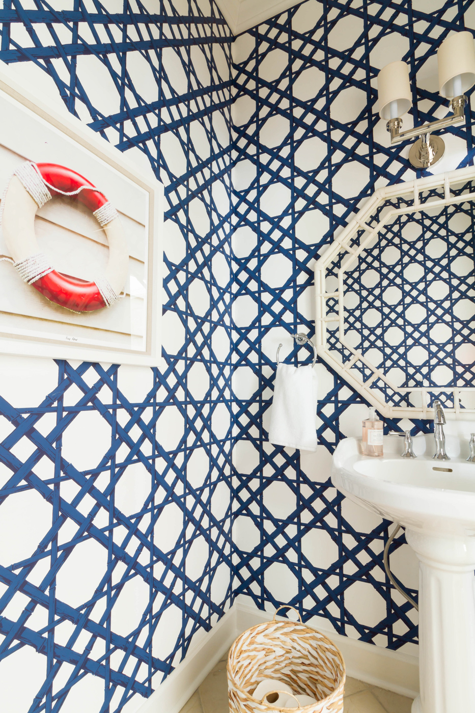 Eclectic Home Tour - love the blue trellis wallpaper in this powder room and the coastal art #wallpaper #powderroom #bathroomdecor