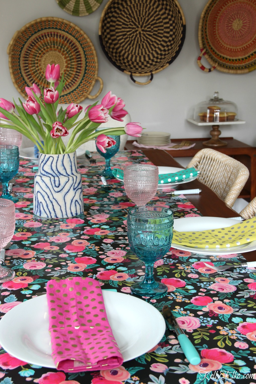 Beautiful spring table - love the floral table runner, blue and pink glasses and colorful napkins kellyelko.com