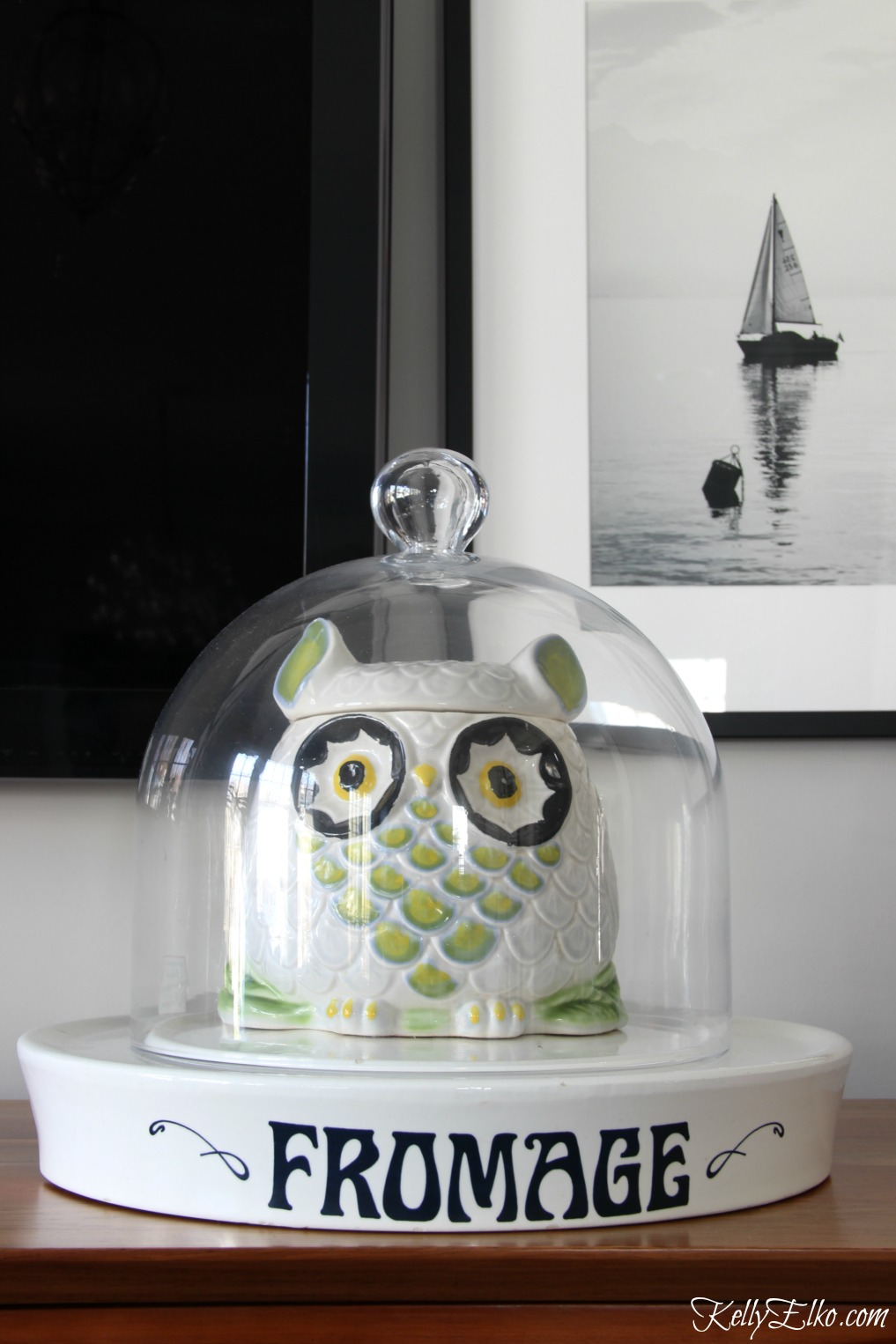 Love this family room and her fun accessories including an owl cookie jar under a cloche kellyelko.com #owl #homedecor #homeaccessories