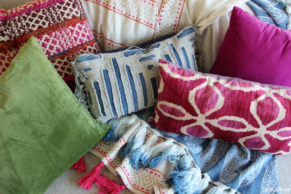 Eclectic mix of pillows and throws in blues, pinks and greens kellyelko.com