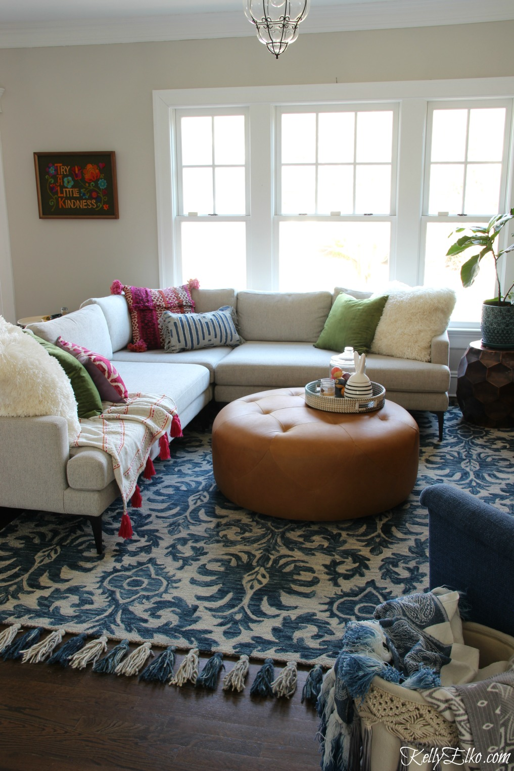 Love this spring family room in blues, pinks and greens kellyelko.com #familyroom #homedecor #sectional #bohodecor
