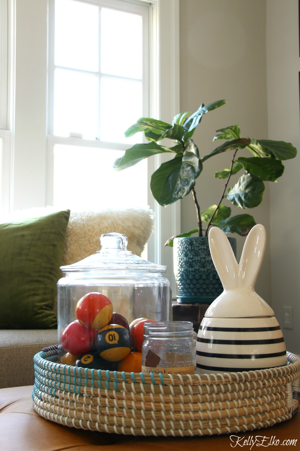 Love this spring family room and the cute woven basket filled with vintage pool balls and a modern bunny jar kellyelko.com #springdecor #homedecor #vintagedecor #bunny