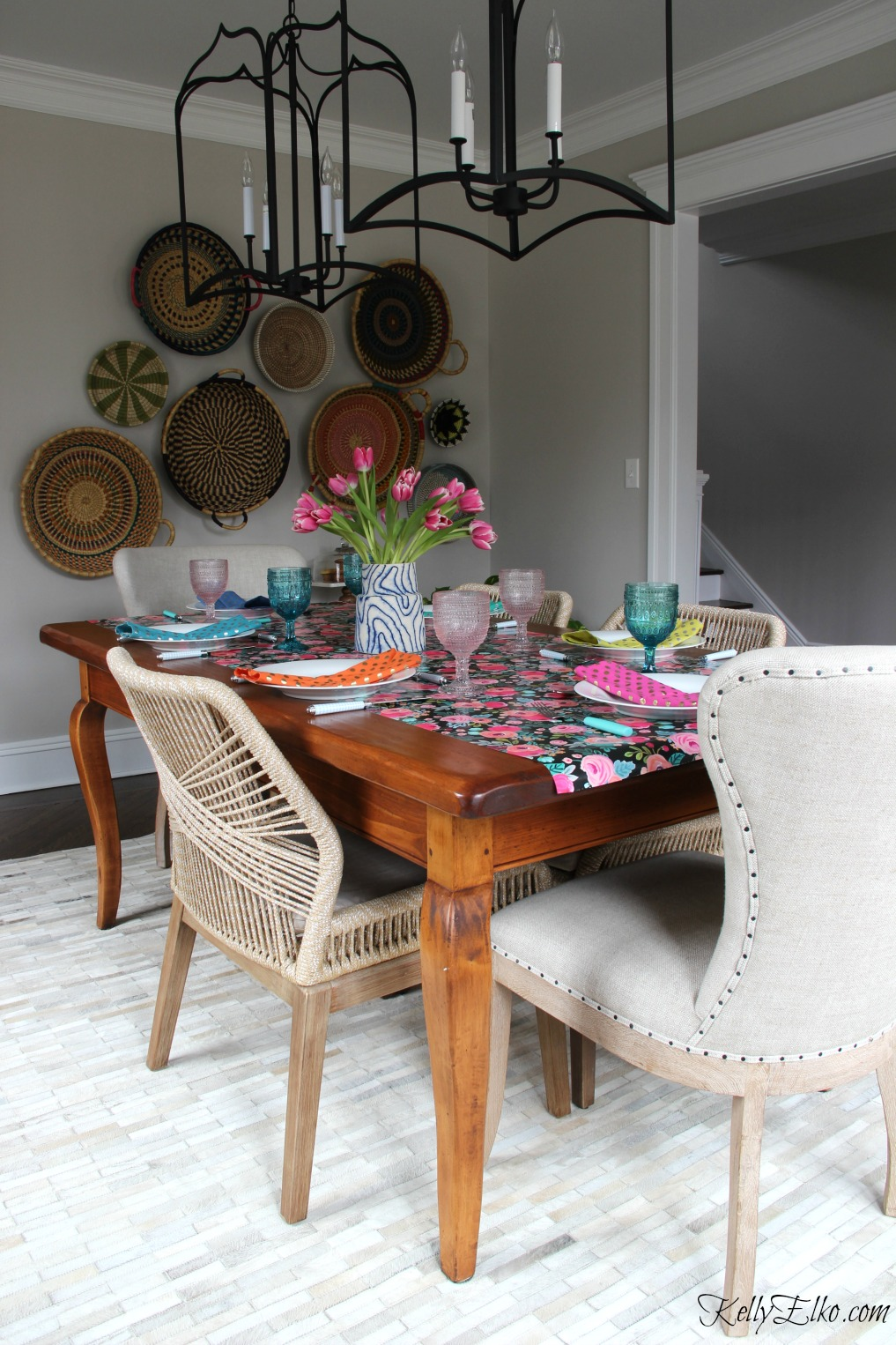 Spring table - love the graphic floral table runner with blue and pink glasses, colorful napkins and beautiful cowhide rug and rope chairs kellyelko.com