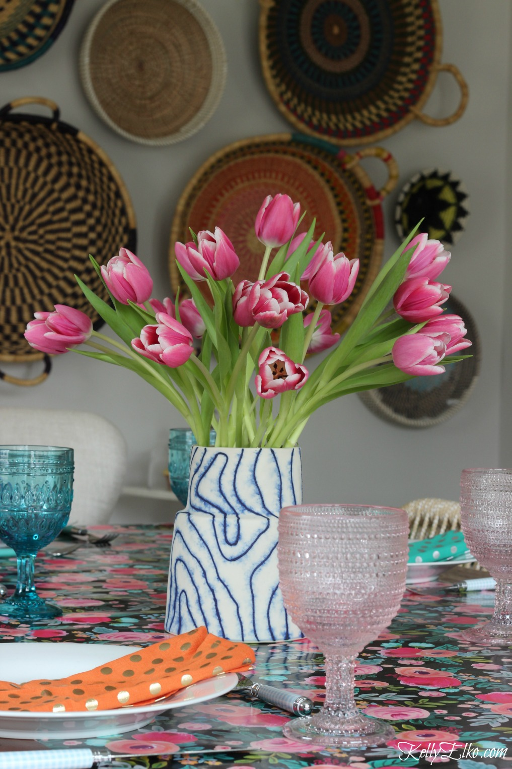 Spring table - love the blue and pink glasses and tulip centerpiece kellyelko.com