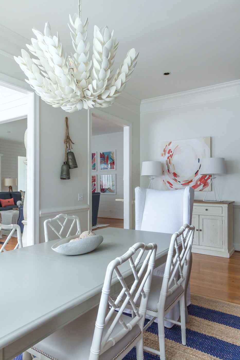 Eclectic Home Tour - statement chandelier and colorful art in a white dining room #diningroom #lighting #diningroomdecor