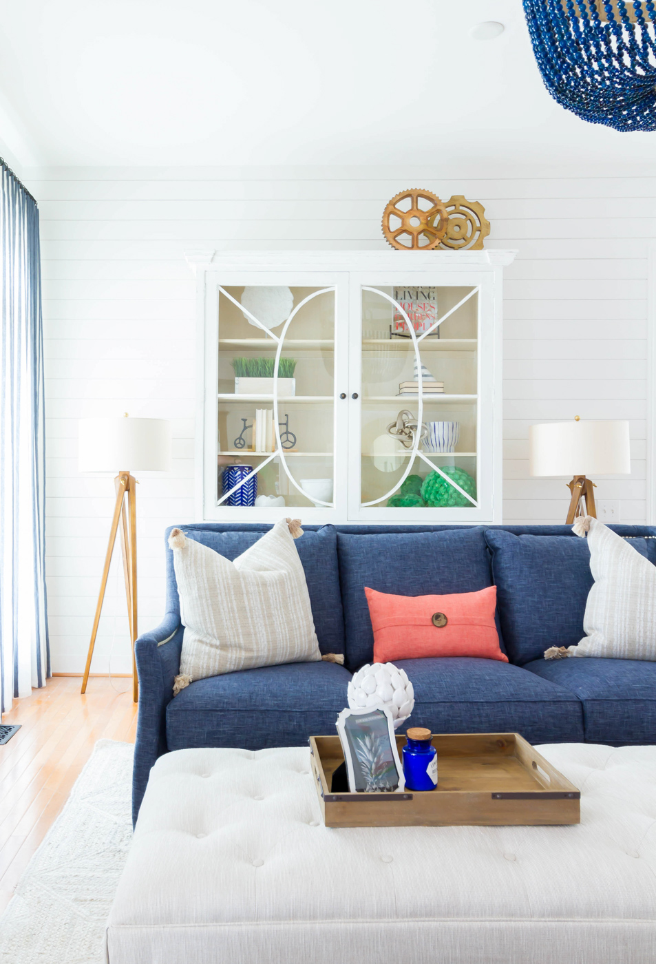 Eclectic Home Tour - love the white shiplap walls as a backdrop for blue sofas and chandelier #shiplap #neutraldecor #coastaldecor