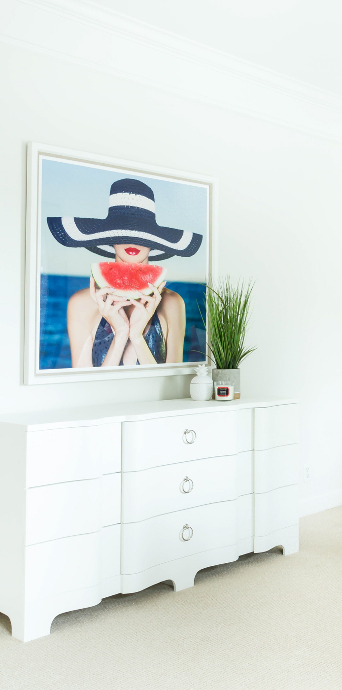 Eclectic Home Tour - love the fun woman with watermelon art in this lake house #art #bedroomdecor