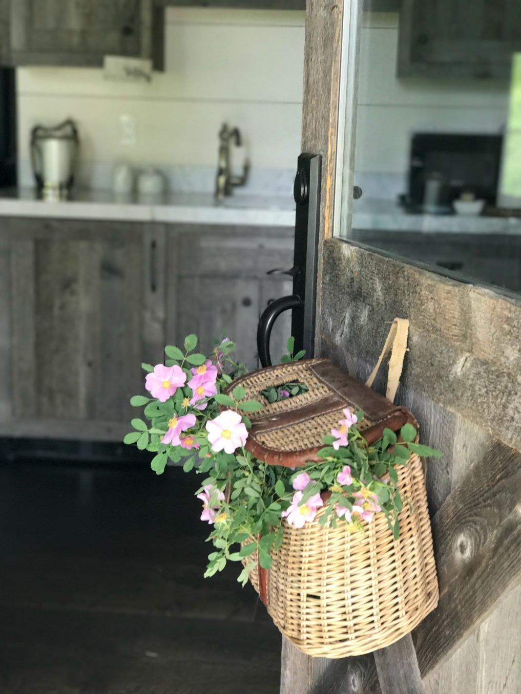 Eclectic Home Tour of Sanctuary Home - welcome to Crow Hollow Ranch. This 500 acre property is complete with farmhouse, guest house and rustic cabin kellyelko.com #hometour #frontdoor #vintage #rusticdecor #barnwood #whitekitchen #homedecor