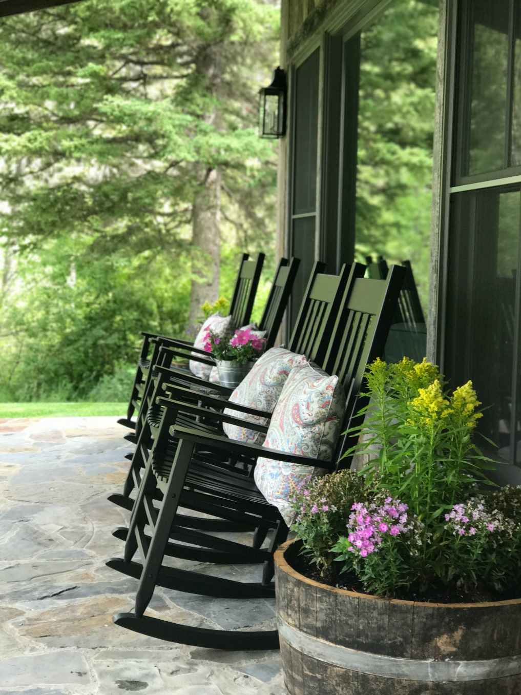 Eclectic Home Tour of Sanctuary Home - welcome to Crow Hollow Ranch. This 500 acre property is complete with farmhouse, guest house and rustic cabin kellyelko.com #hometour #porch #rusticdecor #barnwood #whitekitchen #homedecor