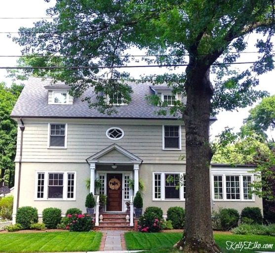 Old house with green paint - love the dormers, front porch and landscaping kellyelko.com #oldhouse #curbappeal #paintcolors #exteriorpaint