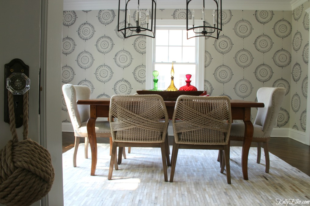 Forget wallpaper! This hand painted mural is like faux wallpaper minus the expense and I love the rope chairs and pair of giant lanterns kellyelko.com #wallpaper #mural #diningroom #wallart #handpainted